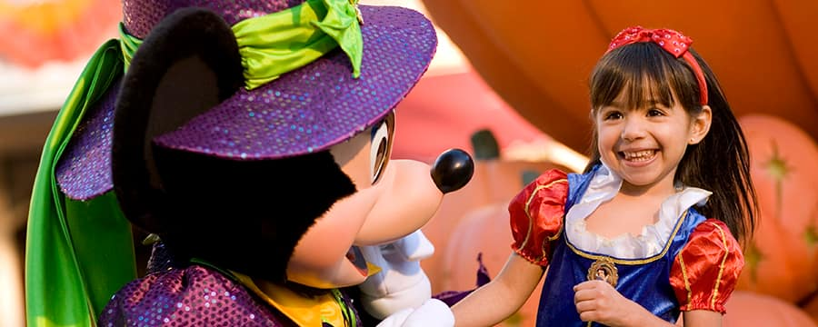 Costumed Mickey meets a girl dressed as Snow White during Mickey's Halloween Party