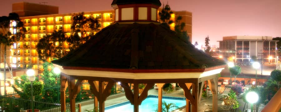 A gazebo close to a pool at the Anaheim Camelot Inn & Suites