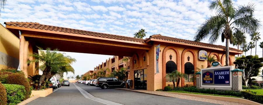 The driveway entrance to Best Western Plus Anaheim Inn with a tiled roof