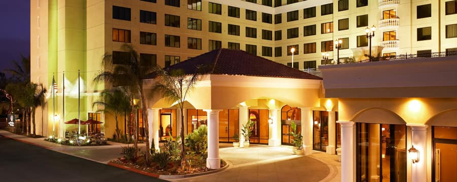 The carport and entrance to DoubleTree Suites by Hilton lit up at night