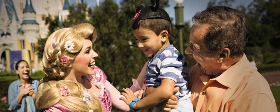 Rapunzel smiles at a little boy and his grandfather