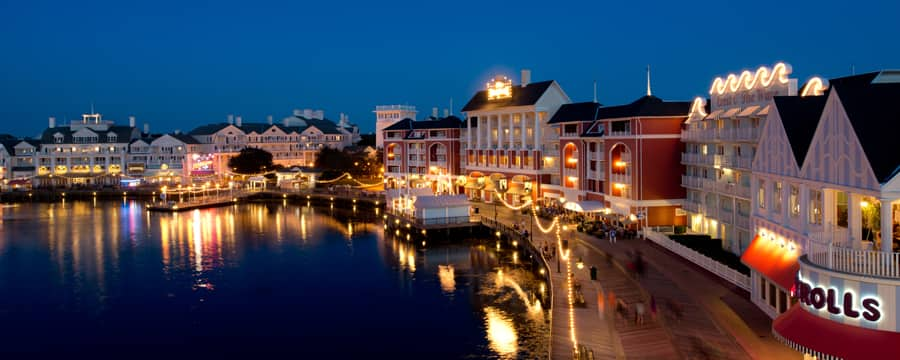 Panoramic view of Disney's BoardWalk Inn and Crescent Lake, lit up at night