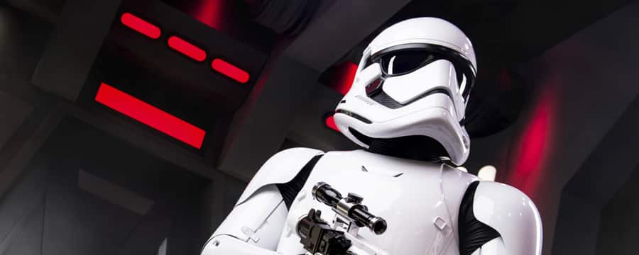 An imperial stormtrooper holds his blaster