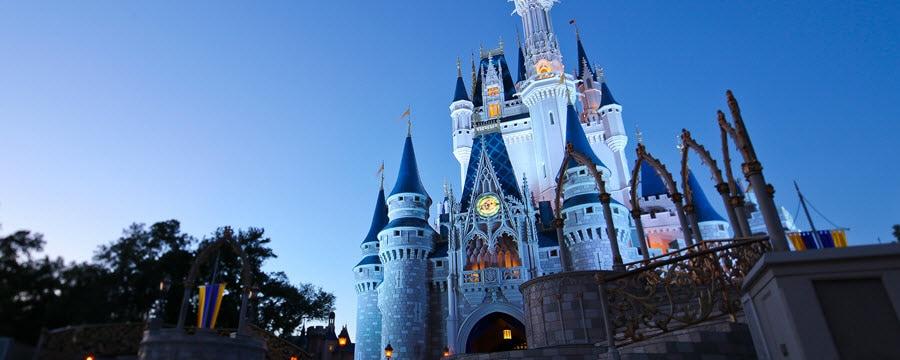 Cinderella Castle towering into the evening sky above Magic Kingdom park at Walt Disney World Resort