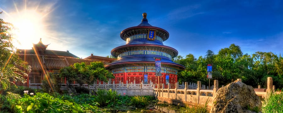 Under an amazing sunburst, the China Pavilion majestically sits by a pond packed with lily pads