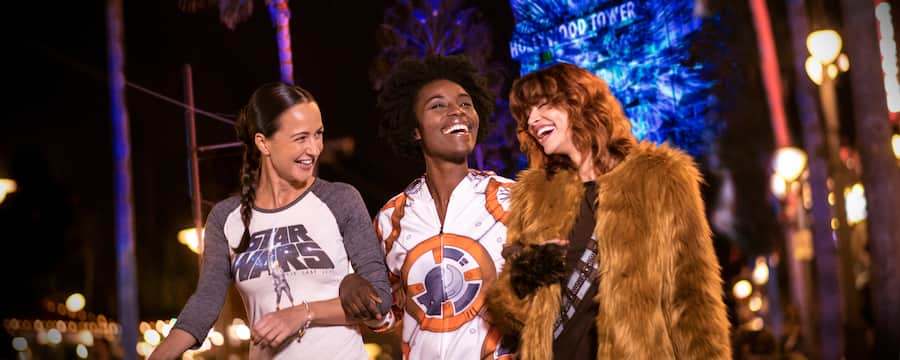 3 friends dressed in Star Wars attire walk around Walt Disney World Resort