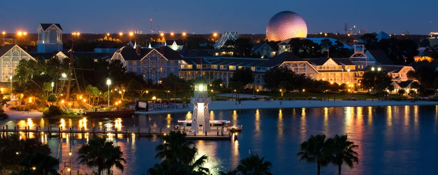 A Nighttime View Of Disney S Beach Club Resort From Crescent Lake