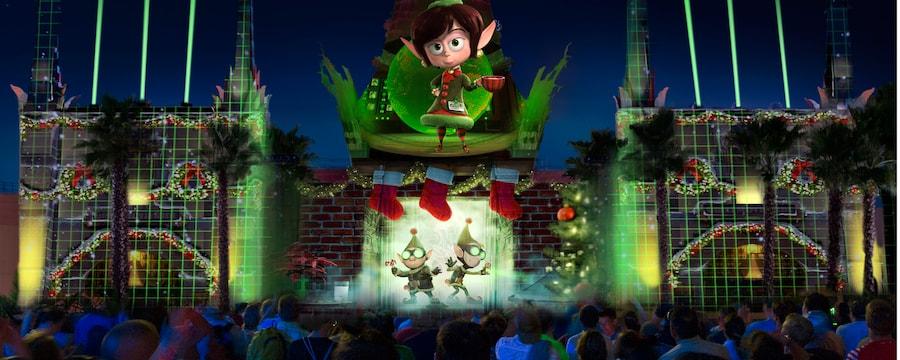Un espectáculo de luces con Personajes de la película de Disney, Prep and Landing, proyectada en el exterior del Chinese Theater en Disney's Hollywood Studios