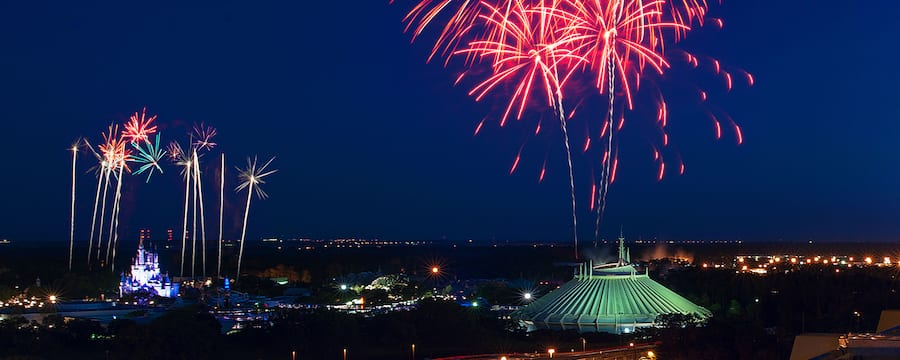Fireworks bursting in the night sky above Magic Kingdom park