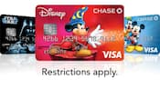 A collection of three Disney Visa Chase credit cards featuring Sorcerer Mickey, Mickey and friends and Darth Vader