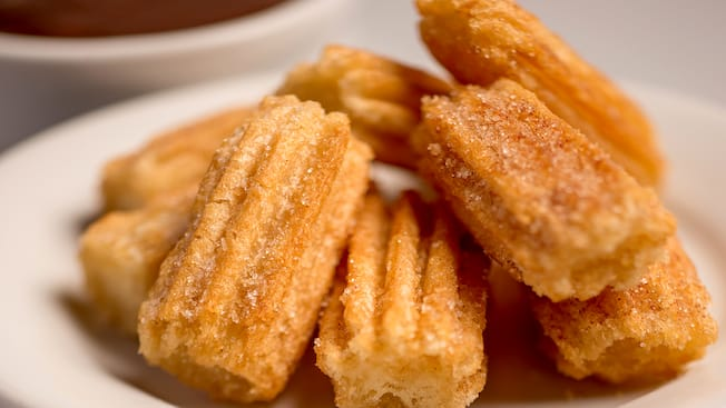 A pile of churro bites on a plate